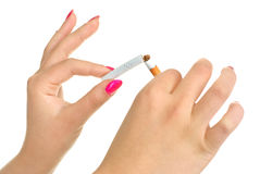 Woman breaking a cigarette Stock Image