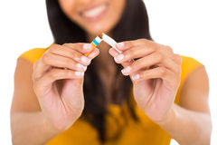 Woman breaking cigarette Royalty Free Stock Photo