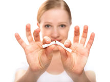 Woman breaking cigarette. concept stop smoking Stock Photo