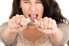 Woman breaking cigarette. concept stop smoking Stock Image