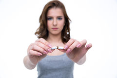 Woman breaking cigarette and no smoking concept. Young woman breaking cigarette and no smoking concept. Focus on cigarette Royalty Free Stock Photography