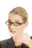 Woman breaking cigarette to stop smoking Stock Photography