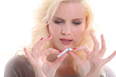 Woman breaking a cigarette Stock Images
