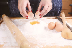 Woman breaking an egg. Royalty Free Stock Photography