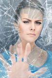 Woman breaking glass Royalty Free Stock Photos