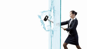 Woman breaking glass Royalty Free Stock Images