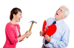 Woman breaking heart of an old man Stock Images