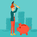Woman breaking piggy bank. Stock Images