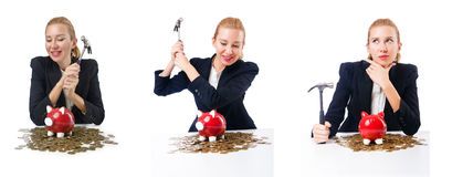The woman breaking piggy bank for savings Royalty Free Stock Image