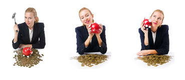 The woman breaking piggy bank for savings Stock Images