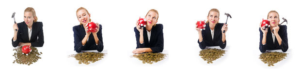 The woman breaking piggy bank for savings Stock Photos