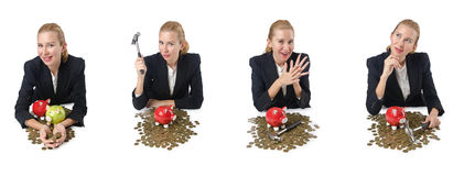 The woman breaking piggy bank for savings Royalty Free Stock Images