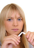 Woman breaks a cigarette Stock Photo