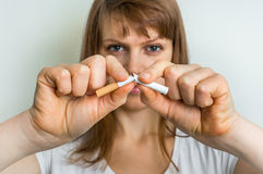 Woman breaks down the cigarette Royalty Free Stock Photo