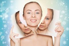 Woman breaks photo with her old face and demonstrating pure skin Stock Image