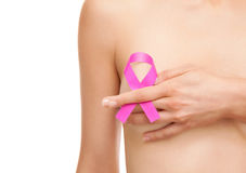 Woman with a breast cancer awareness ribbon Stock Photos