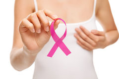 Woman with breast cancer awareness ribbon. Woman with a pink breast cancer awareness ribbon royalty free stock photo