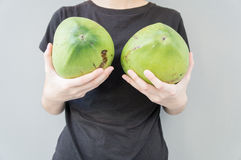 Woman breast coconut fruit implant upsize metaphor concept Stock Images