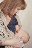 Woman breast feeding baby Royalty Free Stock Photography