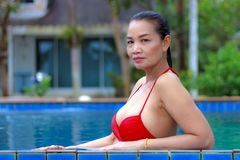 Woman breast sexy portrait with red bikini at swimming pool. On beach at Bang Boet  beach, Prachuap Khirikhan Province Thailand Stock Photo