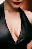 Woman breasts in leather top. Outdoors Royalty Free Stock Photos