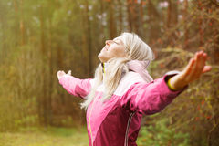 Woman breathes fresh air outdoors in autumn stock photos