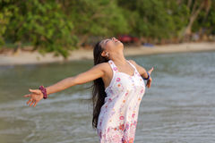 Woman breathing on beach Royalty Free Stock Photography