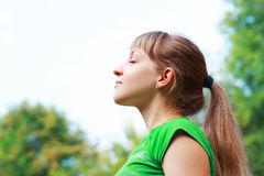 Woman breathing fresh air Stock Image
