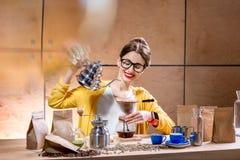 Woman brewing alternative coffee Stock Photos