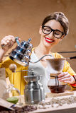 Woman brewing alternative coffee Royalty Free Stock Photo