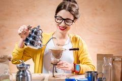 Woman brewing alternative coffee Stock Photography
