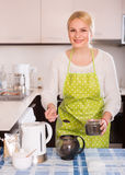 Woman brewing tea Royalty Free Stock Photography