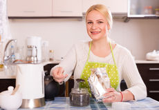 Woman brewing tea Stock Image
