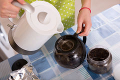 Woman  brewing tea at home Stock Image