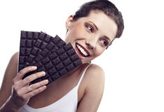 Woman with a brick of chocolate Stock Images