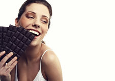 Woman with a brick of chocolate Royalty Free Stock Photography