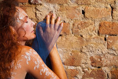 Woman brick wall dreaming Royalty Free Stock Photo