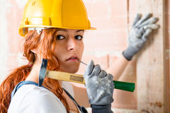 Woman Bricklayer with Hammer Stock Image