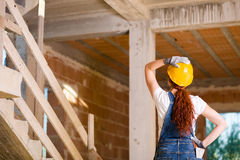 Woman Bricklayer Watching Upstairs Royalty Free Stock Image