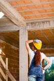Woman Bricklayer Watching Upstairs Royalty Free Stock Images