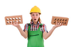 Woman with bricks isolated Royalty Free Stock Photos