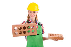 Woman with bricks Royalty Free Stock Images