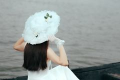 Woman With Bridal White Hat and Gloves Admiring the Sea. Elegant bride having something old, new, borrowed and blue stock images