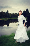 Woman bride. Portrait lake and forest background stock photography