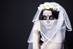 Woman bride with creative sugar skull make up and bridal veil ov Stock Images
