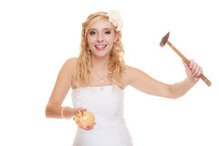 Woman bride with hammer about to smash piggy bank. Money saving, marriage and high wedding cost concept. Funny woman bride with hammer about to smash piggy bank Stock Photo