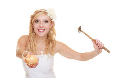 Woman bride with hammer about to smash piggy bank. Money saving, marriage and high wedding cost concept. Funny woman bride with hammer about to smash piggy bank Royalty Free Stock Photo
