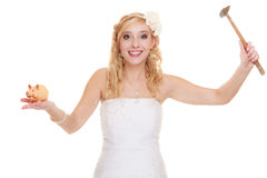 Woman bride with hammer about to smash piggy bank. Money saving, marriage and high wedding cost concept. Funny woman bride with hammer about to smash piggy bank Stock Photography