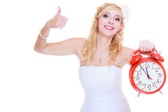 Woman bride holding big red clock Stock Images