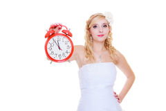 Woman bride holding big red clock Royalty Free Stock Image
